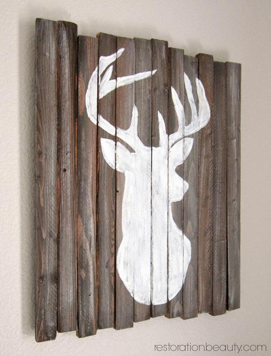 wooden-stakes-deer-head-silhouette