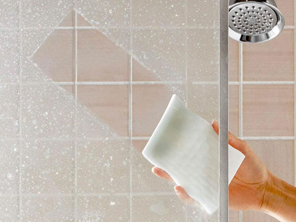 Scrub-Cleaning-Glass-Shower-Easily